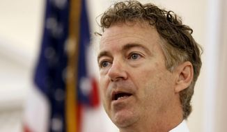 In this Oct. 9, 2015, photo, Republican presidential candidate Sen. Rand Paul, R-Ky. speaks during a campaign stop at the Republican Liberty Caucus in Nashua, N.H.  A defiant Paul is brushing off weak fundraising and weaker poll numbers as some Republicans begin pushing him to abandon his presidential ambitions to focus on his Senate re-election. The first-term Kentucky senator this week claimed his superior political organization would prove wrong those doubting his chances in the White House contest. (AP Photo/Jim Cole, File)