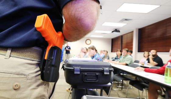 """Clark Aposhian speaks to teachers during a concealed firearm permit class named """"Safe to Learn, Safe to Teach"""" in South Jordan, Utah, Friday, Oct. 16, 2015. (Jeffrey D. Allred/The Deseret News via AP)"""
