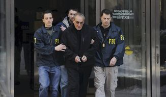 "In this Jan. 23, 2014, file photo, FBI agents flank Vincent Asaro as they escort him from FBI offices in New York. More than 30 years after one of the largest cash robberies in U.S. history, the now 80-year-old Asaro will stand trial in New York for helping to plan the heist that became immortalized in the Martin Scorsese mob movie ""Goodfellas."" (Charles Eckert/Newsday, via AP, File) NYC OUT"