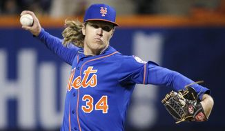 New York Mets pitcher Noah Syndergaard throws during the first inning of Game 2 of the National League baseball championship series against the Chicago Cubs Sunday, Oct. 18, 2015, in New York. (AP Photo/Julie Jacobson)