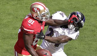 San Francisco 49ers wide receiver Anquan Boldin (81) stiff-arms Baltimore Ravens defensive back Kyle Arrington during the first half of an NFL football game in Santa Clara, Calif., Sunday, Oct. 18, 2015. (AP Photo/Marcio Jose Sanchez) **FILE**