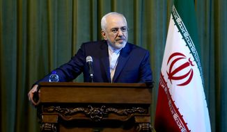 Iranian Foreign Minister Mohammad Javad Zarif listens to a question during a press conference with his German counterpart Frank-Walter Steinmeier in Tehran, Iran, Saturday, Oct. 17, 2015. (AP Photo/Ebrahim Noroozi)