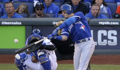 Toronto Blue Jays' Troy Tulowitzki hits an RBI double during the sixth inning in Game 2 of baseball's American League Championship Series against the Kansas City Royals on Saturday, Oct. 17, 2015, in Kansas City, Mo. (AP Photo/Jae C. Hong)