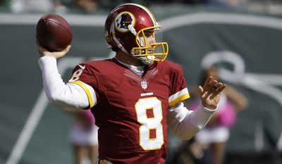 Washington Redskins quarterback Kirk Cousins throws against the New York Jets during the first half of an NFL football game, Sunday, Oct. 18, 2015, in East Rutherford, N.J. (AP Photo/Seth Wenig)