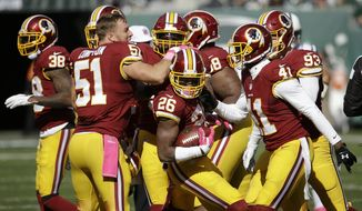Washington Redskins players celebrate after Bashaud Breeland (26) recovered a fumble against the New York Jets during the first half of an NFL football game, Sunday, Oct. 18, 2015, in East Rutherford, N.J. (AP Photo/Seth Wenig)