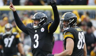 Pittsburgh Steelers quarterback Landry Jones (3) celebrates with tight end Matt Spaeth (89) after throwing a touchdown pass to wide receiver Martavis Bryant in the fourth quarter an NFL football game against the Arizona Cardinals, Sunday, Oct. 18, 2015 in Pittsburgh. The Steelers won 25-13. (AP Photo/Gene J. Puskar)