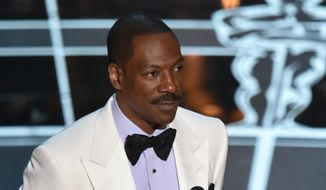 In this Feb. 22, 2015, file photo, Eddie Murphy presents the award for best original screenplay at the Oscars at the Dolby Theatre in Los Angeles. (Photo by John Shearer/Invision/AP, File)