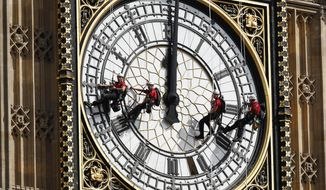 In this file photo dated  Monday, Aug. 18, 2014, workers abseil outside the clock face as they clean Big Ben's clock tower of the Houses of Parliament in London.  According to reports published Sunday Oct. 18, 2015, the chimes of Big Ben may fall silent for many months as urgent repairs are carried out to the clock and the tower, which  must begin as soon as possible.(AP Photo/Sang Tan) ** FILE **