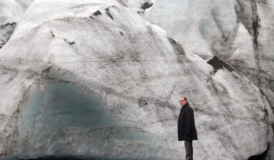 France's President Francois Hollande walks on the Solheimajokull glacier, where the ice has retreated by more than 1 kilometer (0.6 miles), during a State visit in Iceland, Friday, Oct. 16, 2015. Francois Hollande is in Iceland to experience firsthand the damage caused by global warming, ahead of major U.N. talks on climate change in Paris this year. (AP Photo/Thibault Camus, Pool)