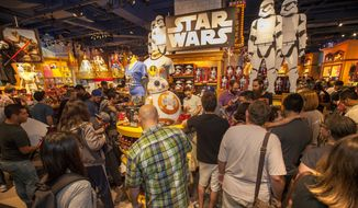 "Fans enjoy midnight madness as ""Force Friday"" kicked off to celebrate the launch of merchandise for ""Star Wars: The Force Awakens,"" on Friday, Sept. 4 at the Michigan Ave Disney Store in Chicago. (Associated Press)"