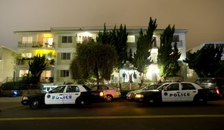"FILE - In this June 22, 2011, file photo, police and FBI surround the apartment building in Santa Monica, Calif., where fugitive crime boss James ""Whitey"" Bulger and his longtime companion Catherine Greig were arrested. Greig is expected in federal court on Monday, Oct. 19, 2015, to face a contempt charge for allegedly refusing to tell whether other people helped the Boston mobster during his 16 years on the run. (AP Photo/David Zentz, File)"