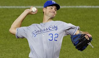 Kansas City Royals starting pitcher Chris Young throws against the Toronto Blue Jays during the first inning in Game 4 of baseball's American League Championship Series on Tuesday, Oct. 20, 2015, in Toronto. (AP Photo/Paul Sancya)