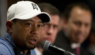 Tiger Woods responds to a question during a press conference to launch the Bridgestone America's Golf Cup in Mexico City, Tuesday, Oct. 20, 2015. Woods withdrew from the Bridgestone America's Golf Cup and two other events he had planned to play this year following back surgery. He isn't expected to return to the tour until January at the earliest. (AP Photo/Rebecca Blackwell)