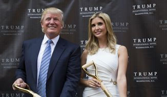 In this July 23, 2014, file photo, Donald Trump and his daughter Ivanka Trump pose for photographs during a ground-breaking ceremony for the Trump International Hotel on the site of the Old Post Office in Washington. (AP Photo, File)