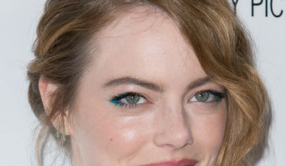 """Emma Stone arrives at the Los Angeles Premiere of """"Irrational Man"""" held at the WGA Theatre on Thursday, July 9, 2015, in Beverly Hills, Calif. (Photo by John Salangsang/Invision/AP)"""