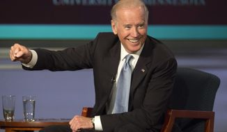 Vice President Joe Biden gestures while participating in a tribute to former Vice President Walter Mondale at George Washington University in Washington on Oct. 20, 2015. (Associated Press)