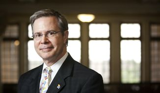 In this photo taken on June 12, 2010, University of Kansas Provost and Executive Vice Chancellor Jeffrey Vitter poses in Strong Hall on the campus of the University of Kansas in Lawrence, Kan. Vitter, named as trustees' top pick to become the next chancellor of the University of Mississippi, says the problem solving of computer science informs his approach as a university administrator. (Nick Krug /The Lawrence Journal-World via AP) MANDATORY CREDIT