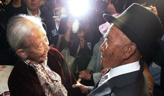 South Korean Lee Soon-kyu, 85, left, meets with her North Korean husband Oh Se In, 83, during the Separated Family Reunion Meeting at Diamond Mountain resort in North Korea, Tuesday, Oct. 20, 2015. Hundreds of elderly Koreans from divided North and South began three days of reunions Tuesday with loved ones many have had no contact with since the war between the countries more than 60 years ago.(Kim Do-hoon/Yonhap via AP)