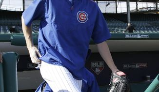 Chicago Cubs pitcher Kyle Hendricks arrives at Wrigley Field for a team workout in preparation for Tuesday's Game 3 in baseball's National League Championship Series against the New York Mets, Monday, Oct. 19, 2015, in Chicago.  (AP Photo/Nam Y. Huh)
