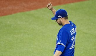 Toronto Blue Jays starting pitcher Marco Estrada acknowledges the crowd while walking off the fieldagainst the Kansas City Royals during the eighth inning in Game 5 of baseball's American League Championship Series on Wednesday, Oct. 21, 2015, in Toronto. (Darren Calabrese/The Canadian Press via AP) MANDATORY CREDIT