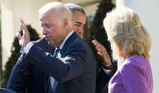 President Barack Obama hugs Vice President Joe Biden as Biden waves at the end Biden's announcement in the Rose Garden of the White House in Washington, Wednesday, Oct. 21, 2015, that he will not run for the presidential nomination.  Jill Biden is at right. (AP Photo/Jacquelyn Martin)