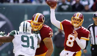 In this Oct. 18, 2015, photo, Washington Redskins quarterback Kirk Cousins (8) throws against the New York Jets during the first half of an NFL football game, in East Rutherford, N.J.  Cousins can't stop throwing interceptions and there are those who wonder how much longer he can hold onto the starting QB job for the Washington Redskins. (AP Photo/Gary Hershorn)