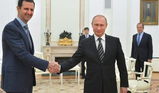 In this photo taken on Tuesday, Oct. 20, 2015, Russian President Vladimir Putin, center, shakes hand with Syrian President Bashar Assad as Russian Foreign Minister Sergey Lavrov, right, looks on in the Kremlin in Moscow, Russia. President Bashar Assad was in Moscow, in his first known trip abroad since the war broke out in Syria in 2011, to meet his strongest ally Russian leader Vladimir Putin. The two leaders stressed that the military operations in Syria_ in which Moscow is the latest and most powerful addition_ must lead to a political process. (Alexei Druzhinin, RIA-Novosti, Kremlin Pool Photo via AP)