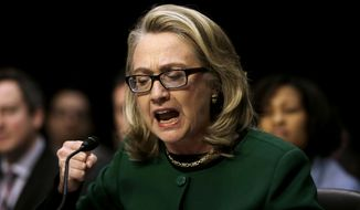 Secretary of State Hillary Rodham as she pounds her fist as she testifies on Jan. 23, 2013 at the Senate Foreign Relations Committee's hearing on the deadly attack on the U.S. diplomatic mission in Benghazi, Libya. (Associated Press)