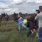 Petra Laszlo, the Hungarian camerawoman who sparked international outrage after she was caught on camera kicking Syrian refugees, has announced plans to sue one of the migrants and Facebook once her criminal trial in Hungary concludes. (YouTube)