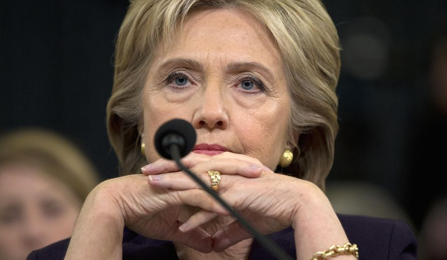 Democratic presidential candidate, former Secretary of State Hillary Rodham Clinton listens as she testifies on Capitol Hill in Washington, Thursday, Oct. 22, 2015, before the House Benghazi Committee. (AP Photo/Evan Vucci)