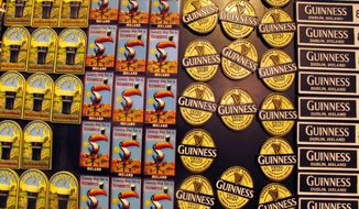 In this Sept. 24, 2014 photo, Guinness logos from different eras are displayed on refrigerator magnets in the ground floor shop of the Guinness Storehouse in Dublin, Ireland. The Guinness Retail Store boasts the largest collection of Guinness-related memorabilia in the world. (AP Photo/Shawn Pogatchnik)