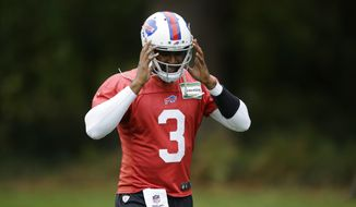 Buffalo Bills quarterback EJ Manuel removes his helmet as he walks off the field at the end of an NFL training session at the Grove Hotel in Chandler's Cross, England, Thursday, Oct. 22, 2015. The Buffalo Bills play the Jacksonville Jaguars at Wembley stadium in London on Sunday in a regular season NFL game.  (AP Photo/Matt Dunham)