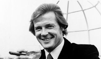 "In this Aug. 1, 1972, file photo, Roger Moore poses for a photograph at the Dorchester Hotel in London, after the announcement that he would play James Bond in ""Live and Let Die."" Moore was the first Englishman to play Bond. (AP Photo/File)"