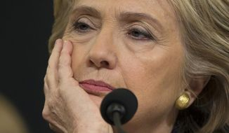 Democratic presidential candidate, former Secretary of State Hillary Rodham Clinton listens while testifying on Capitol Hill in Washington, Thursday, Oct. 22, 2015, before the House Benghazi Committee.  (AP Photo/Evan Vucci)