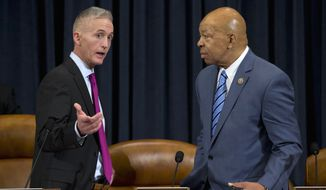 House Benghazi Committee Chairman Rep. Trey Gowdy, R-S.C., left, talks with the committee's ranking member Rep. Elijah Cummings, D-Md. on Capitol Hill in Washington, Thursday, Oct. 22, 2015, prior to the start of the committee's hearing on Benghazi. After months of buildup, Hillary Rodham Clinton finally takes center stage as the star witness in the Republican-led investigation into the deadly 2012 attacks in Benghazi, Libya. (AP Photo/Evan Vucci)
