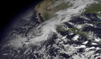 "This satellite image taken at 10:45 a.m. EDT on Friday, Oct. 23, 2015, and released by the National Oceanic and Atmospheric Administration shows Hurricane Patricia moving over Mexico's Pacific Coast. Hurricane Patricia headed toward southwestern Mexico Friday as a monster Category 5 storm, the strongest ever in the Western Hemisphere that forecasters said could make a ""potentially catastrophic landfall"" later in the day.  (NOAA via AP)"