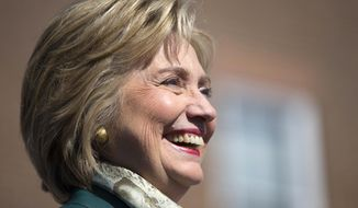 Democratic presidential candidate, former Secretary of State Hillary Rodham Clinton smiles during a campaign rally, Friday, Oct. 23, 2015, in Alexandria, Va.  (AP Photo/Evan Vucci)