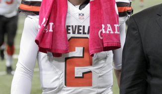 Cleveland Browns quarterback Johnny Manziel walks off the field following an NFL football game against the St. Louis Rams, Sunday, Oct. 25, 2015, in St. Louis. The Rams won 24-6. (AP Photo/Tom Gannam)