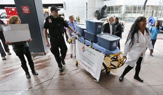 Colorado state Sen. Irene Aguilar (right), a Democrat and a physician, helps deliver more than 156,000 signatures to put a health care question on next year's general election ballot. ColoradoCareYES wants to start the nation's first universal health care plan. (Associated press)