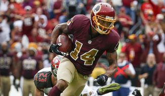 Washington Redskins wide receiver Ryan Grant (14) breaks a tackle by Tampa Bay Buccaneers strong safety Chris Conte (23) during the second half of an NFL football game in Landover, Md., Sunday, Oct. 25, 2015. (AP Photo/Alex Brandon)