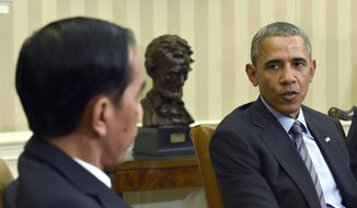 President Barack Obama meets with Indonesian President Joko Widodo in the Oval Office of the White House in Washington, Monday, Oct. 26, 2015. This is Widodo's first visit to the U.S.  since becoming President of Indonesia. (AP Photo/Susan Walsh)