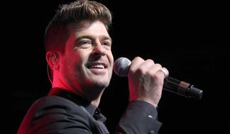 "Robin Thicke performs during ""The Steve Harvey Morning Show"" live broadcast at the Georgia World Congress Center in Atlanta on Aug. 7, 2015. (Robb D. Cohen/Invision/Associated Press) **FILE**"