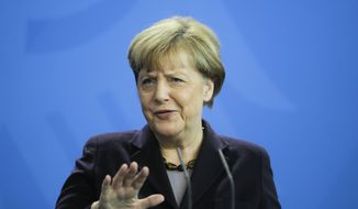 German Chancellor Angela Merkel answers to questions during a news conference with the President  of Honduras Juan Orlando Hernandez, at the chancellery, in Berlin, Tuesday, Oct. 27, 2015. (AP Photo/Markus Schreiber) ** FILE **
