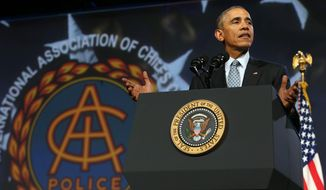 President Barack Obama speaks to the International Association of Chiefs of Police in Chicago, Tuesday, Oct. 27, 2015. (Antonio Perez/Chicago Tribune via AP) MANDATORY CREDIT CHICAGO TRIBUNE; CHICAGO SUN-TIMES OUT; DAILY HERALD OUT; NORTHWEST HERALD OUT; THE HERALD-NEWS OUT; DAILY CHRONICLE OUT; THE TIMES OF NORTHWEST INDIANA OUT; TV OUT; MAGS OUT; NO SALES