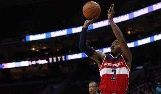 Washington Wizards' John Wall shoots the ball during the second half of an NBA preseason basketball game against the Philadelphia 76ers, Friday, Oct. 16, 2015, in Philadelphia. The Wizards won 127-118. (AP Photo/Chris Szagola)