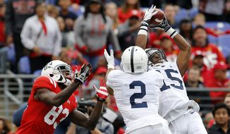 Penn State cornerback Grant Haley (15) makes an interception on a pass attempt to Maryland wide receiver Malcolm Culmer, left, in the first half of an NCAA college football game, Saturday, Oct. 24, 2015, in Baltimore. Also pictured is Penn State safety Marcus Allen (2). (AP Photo/Patrick Semansky)