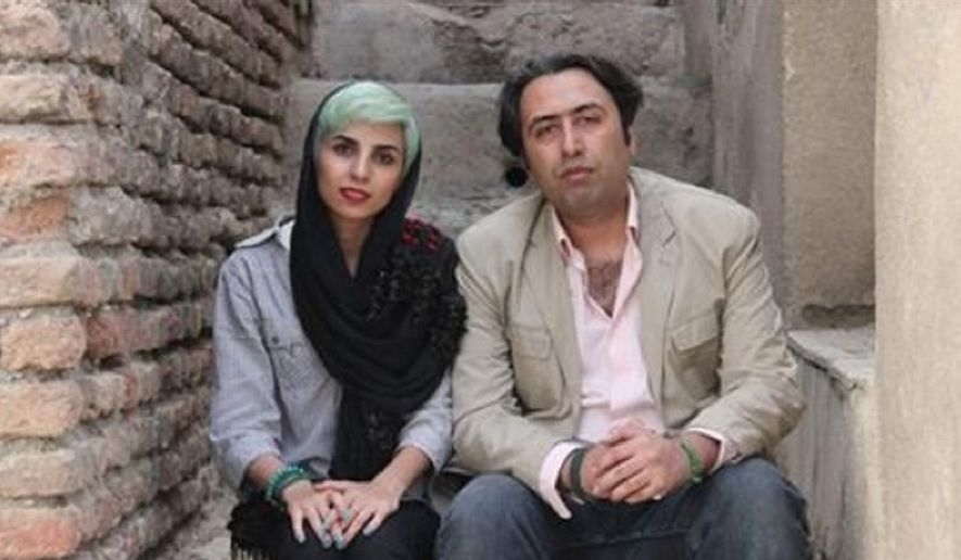 In this undated photo made available by International Campaign for Human Rights in Iran, Iranian poets Fatemeh Ekhtesari , left, and Mehdi Mousavi pose in unknown place in Iran. (International Campaign for Human Rights in Iran via AP)