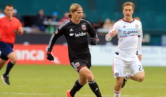 October 18 2015: Chicago Fire midfielder Michael Stephens (26) chases after D.C. United forward Chris Rolfe (18) during a MLS match at RFK Stadium, in Washington D.C. D.C United won 4-0. (Photo by Tony Quinn/Icon Sportswire)  (Icon Sportswire via AP Images)
