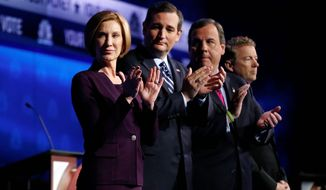 Republican presidential candidates, from left, Carly Fiorina, Ted Cruz, Chris Christie, and Rand Paul take the stage during the CNBC Republican presidential debate at the University of Colorado, Wednesday, Oct. 28, 2015, in Boulder, Colo. (AP Photo/Brennan Linsley)