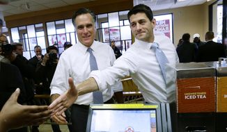In this Nov. 6, 2012, file photo, then-Republican presidential candidate, former Massachusetts Gov. Mitt Romney and his vice presidential running mate, Rep. Paul Ryan, R-Wis., make an unscheduled stop at a Wendy's restaurant in Richmond Heights, Ohio. (AP Photo/Charles Dharapak, File)
